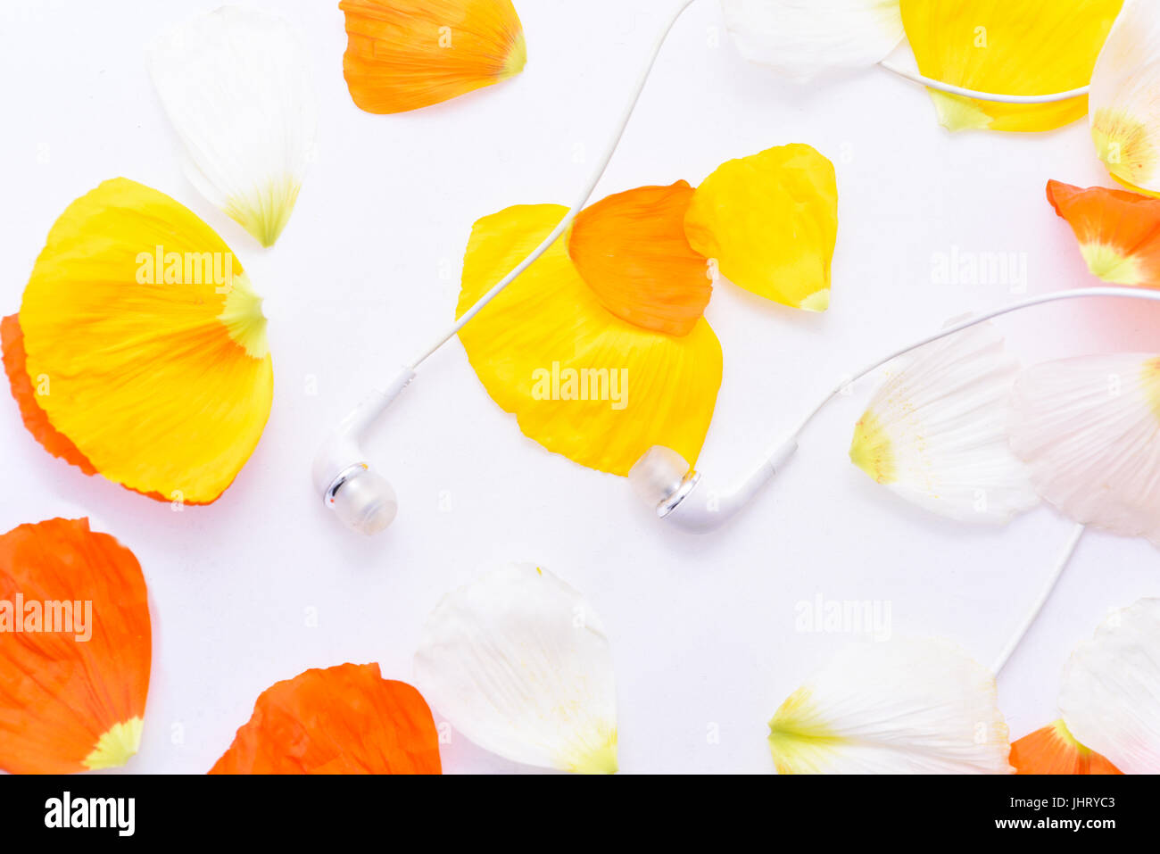 Music abstraction. Autumn texture with white headphones Stock Photo