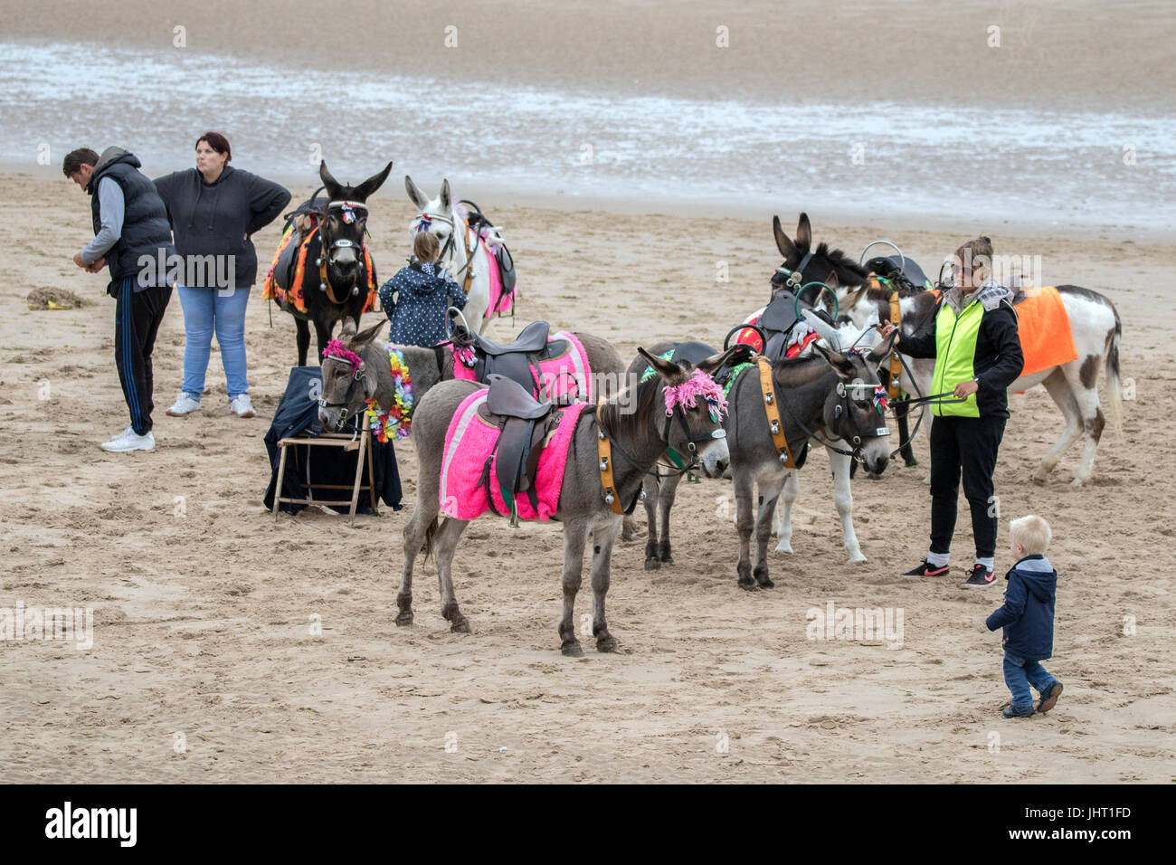 Blackpool, Lancashire, 15th July 2017. UK Weather.  Bad summer weather doesn't deter these holidaymakers from having Stock Photo