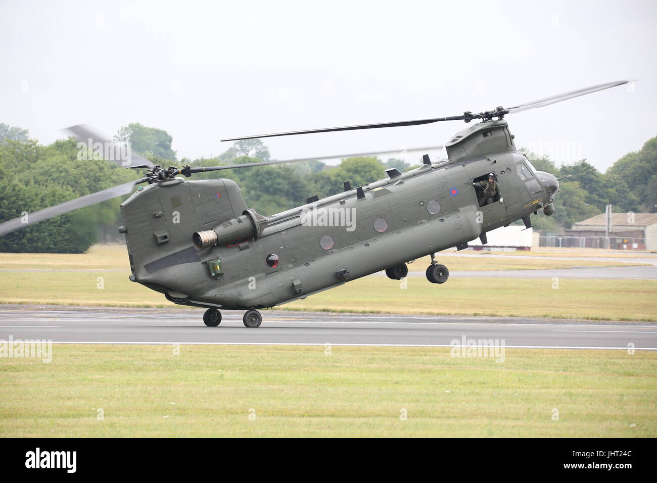 Visitors watched a RAF Boeing Chinook HC.4 taking to the sky in one of the most spectacular displays at this year's - Stock Image