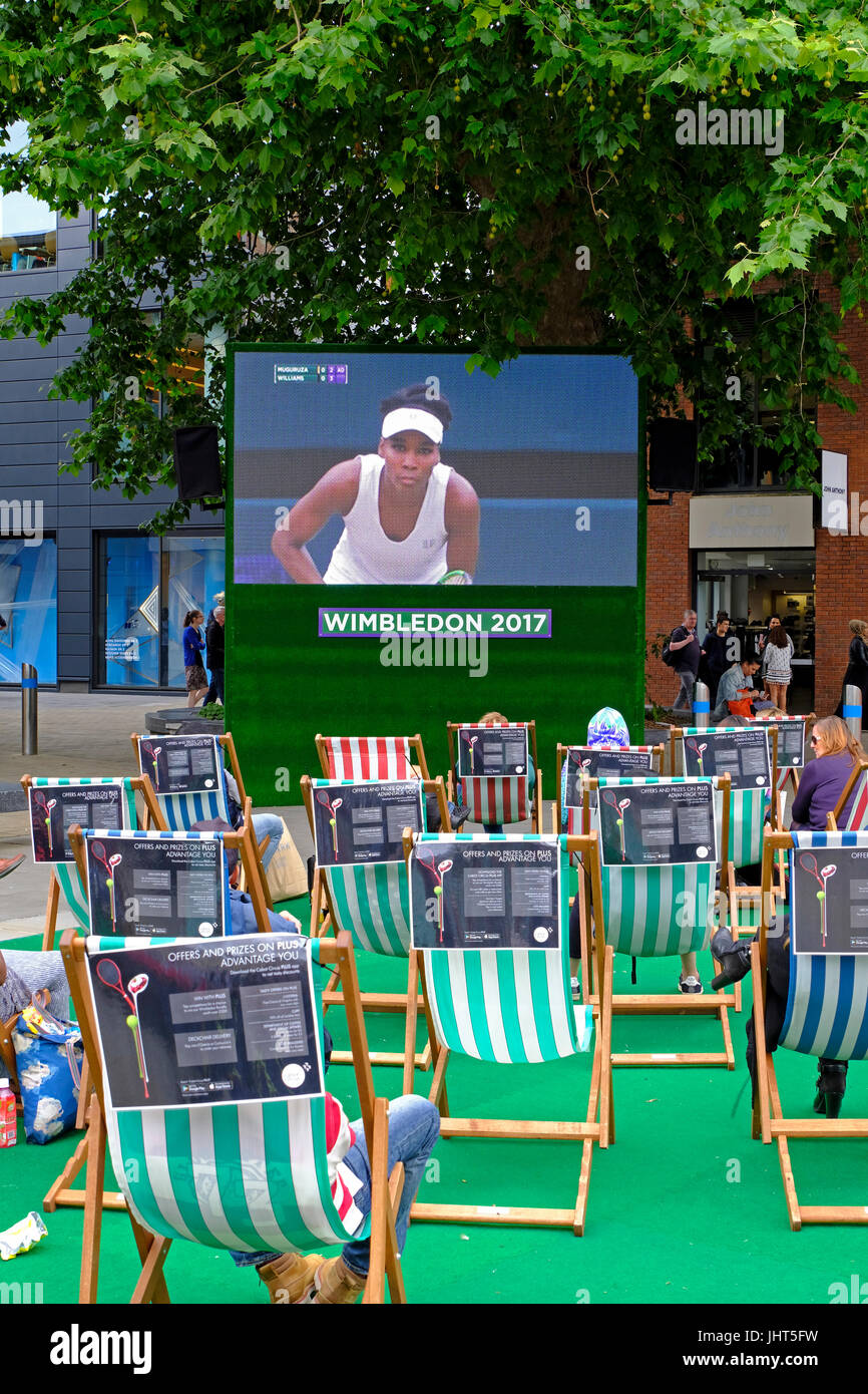 Bristol, UK. 15th July, 2017. Tennis fans watch coverage of the Wimbledon women's singles final on an open-air television - Stock Image