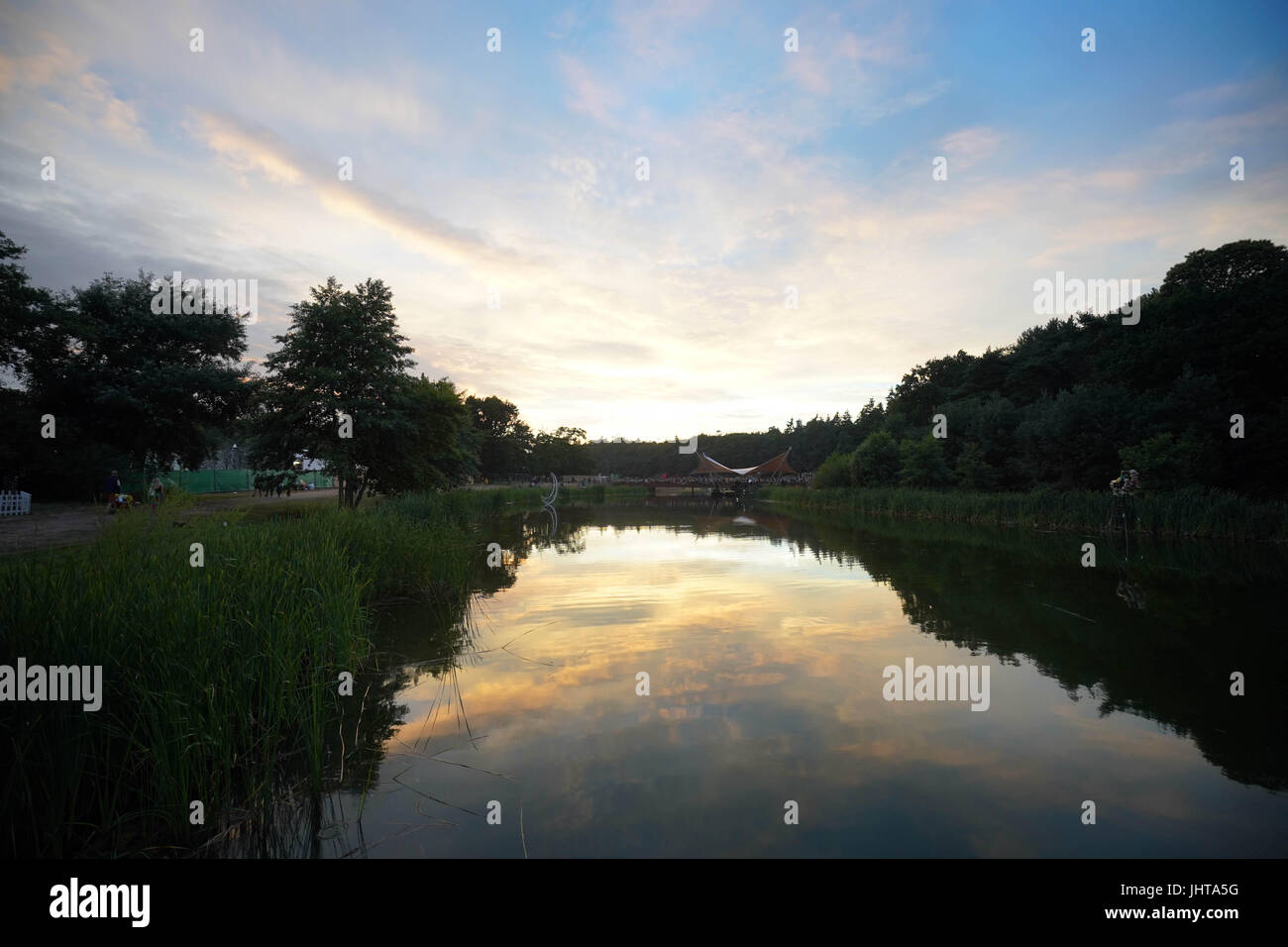 Latitude Festival, UK. 15th July, 2017. A view of the lake at sunset at the 2017 Latitude festival in Henham Park, - Stock Image
