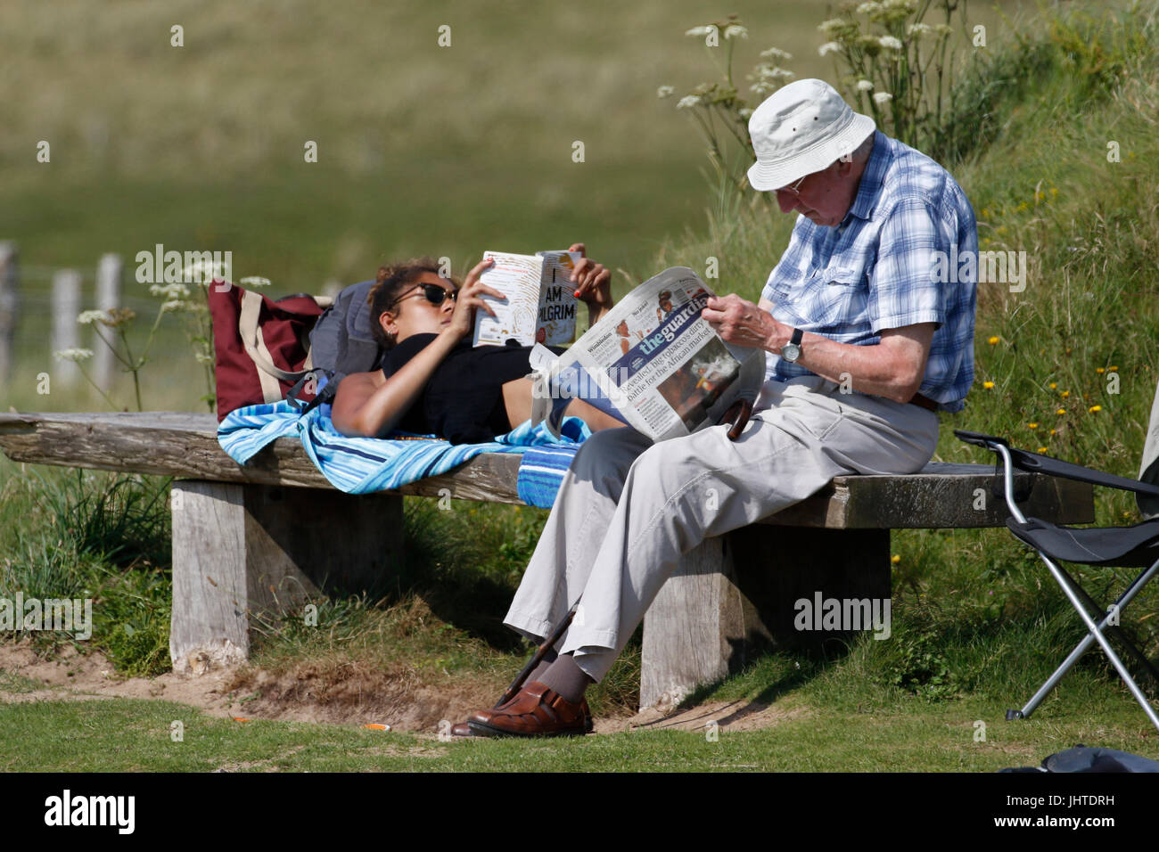 Pemroke, UK. 12th July, 2017.  Weather.  Young and old enjoy the sunshine and warm temperatures at Freshwater West - Stock Image