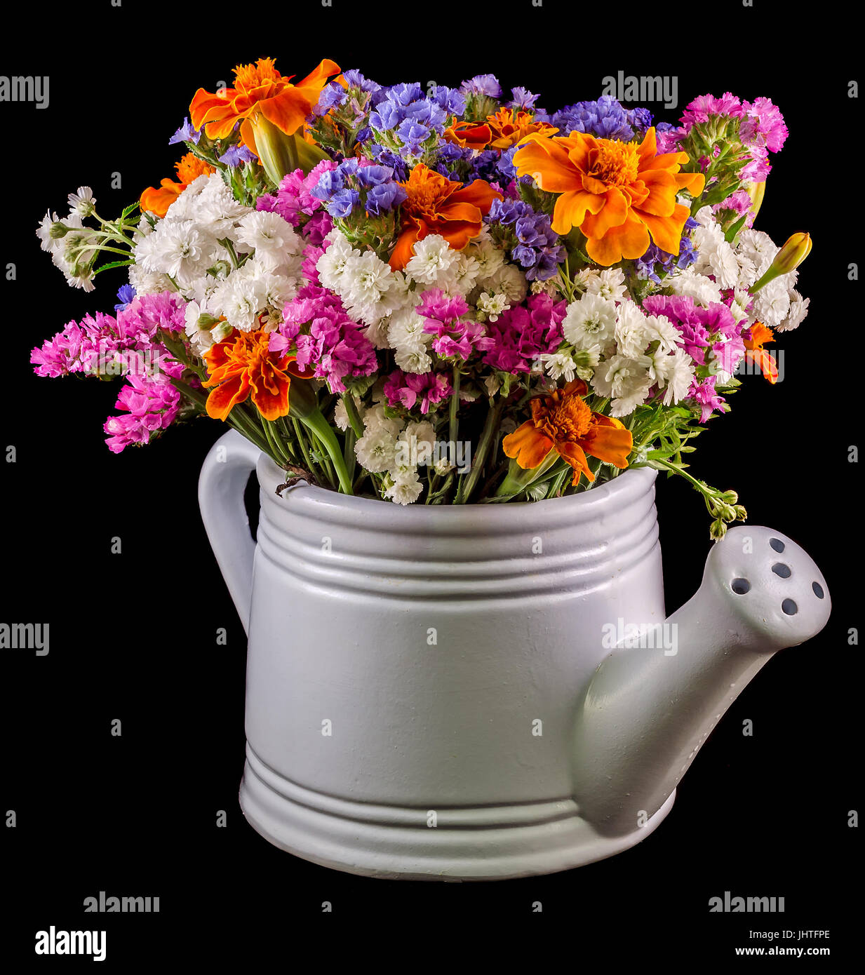 White Ceramic Watercan Sprinkler With Vivid Colored Flowers