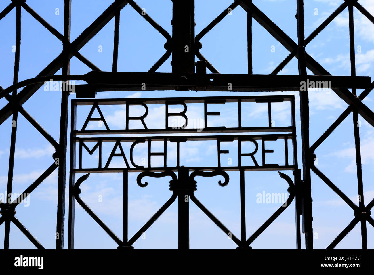 Main entrance gate and 'Arbeit macht frei' sign. Dachau Concentration Camp, Munich, Bavaria, Germany - Stock Image