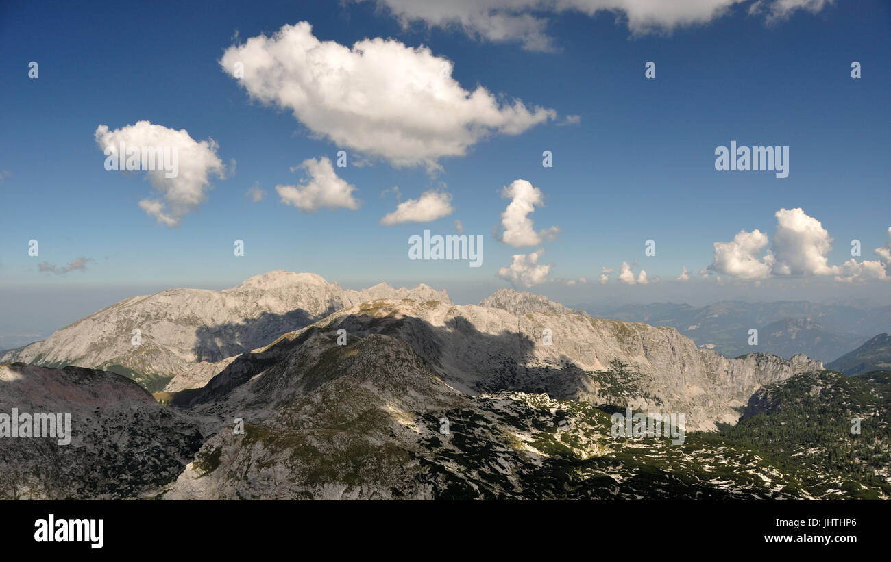 clouds drift over Mt. Hoher Goell and Schneibstein at Berchtesgaden National Park, between Bavaria, Germany and Stock Photo