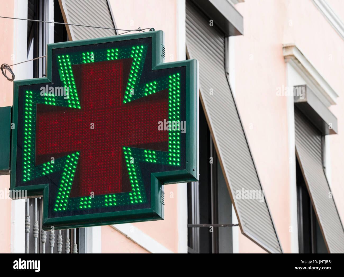 Sign outside chemist (farmacia) in resort in Spain - Stock Image