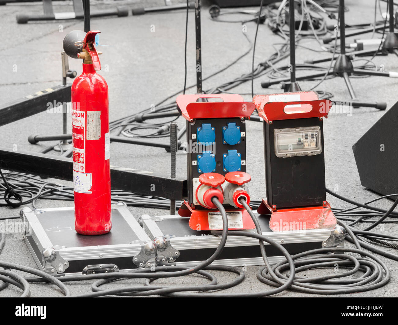 Fire extinguisher on stage at outdoor concert. - Stock Image