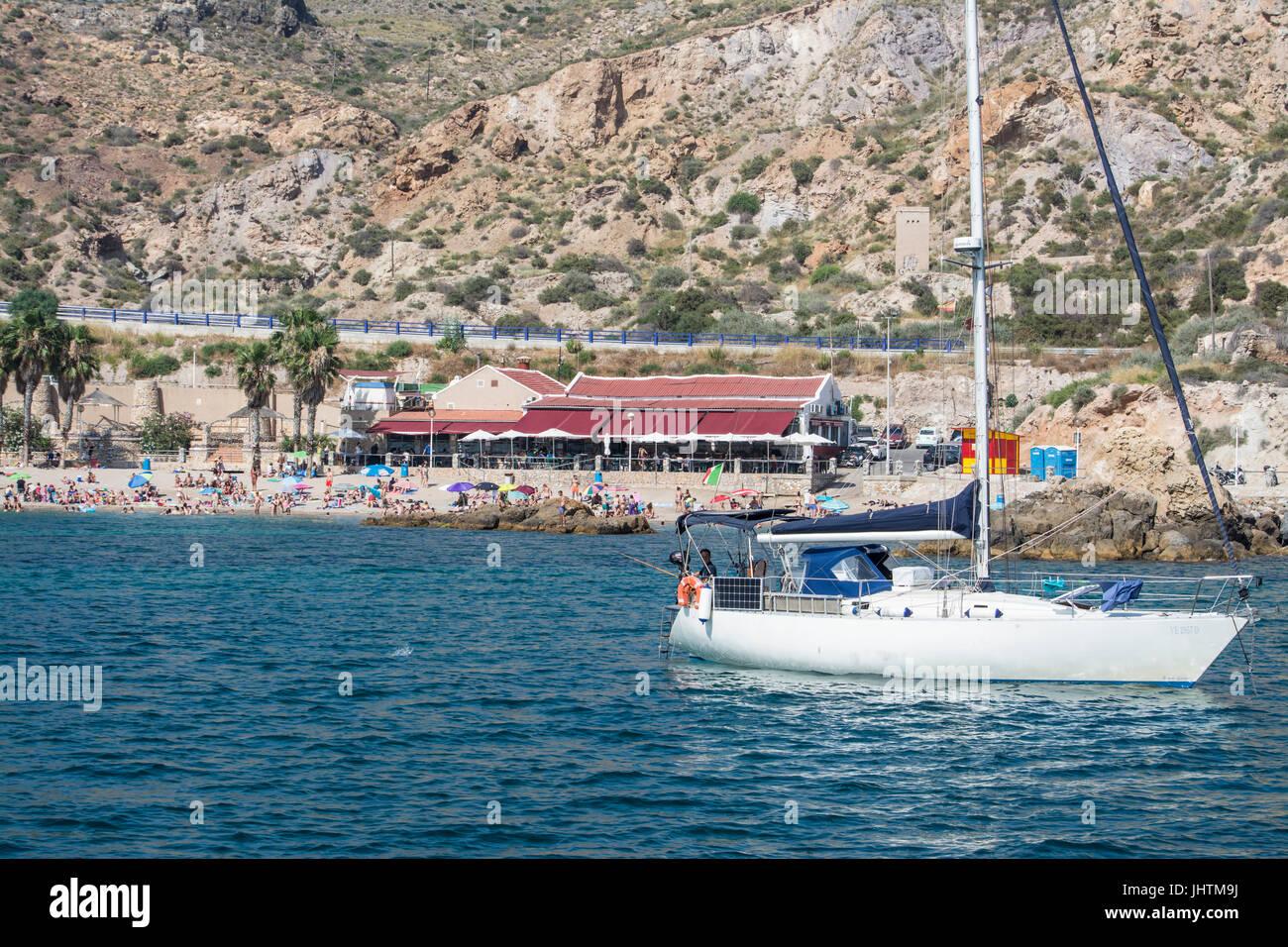 Yacht in the bay at Cala Cortina near Cartagena in Murcia Spain - Stock Image