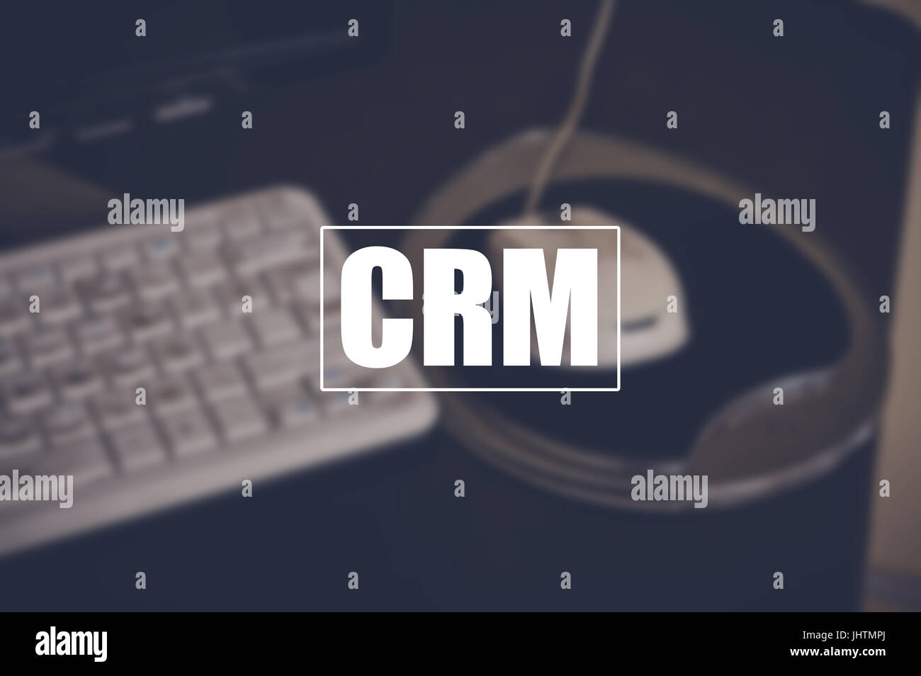 crm word with blurring business background, customer relationship management concept - Stock Image