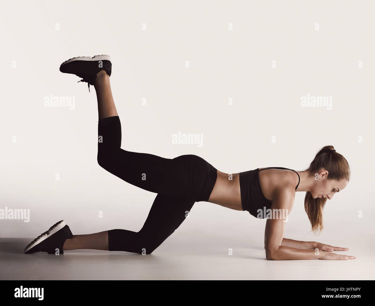 Shot of a young woman doing leg exercises - Stock Image