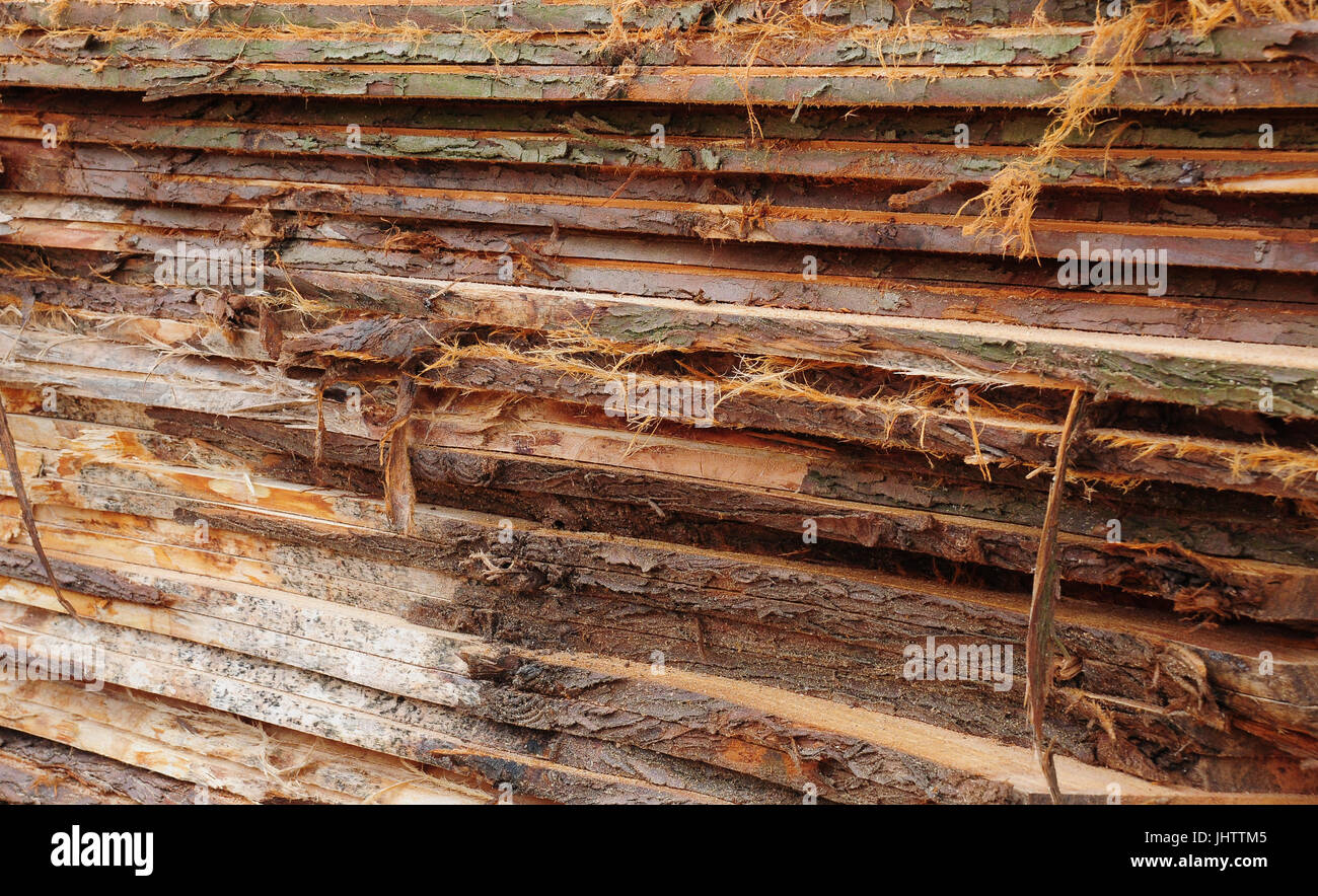 Rough cut planks stacked in a pile - Stock Image