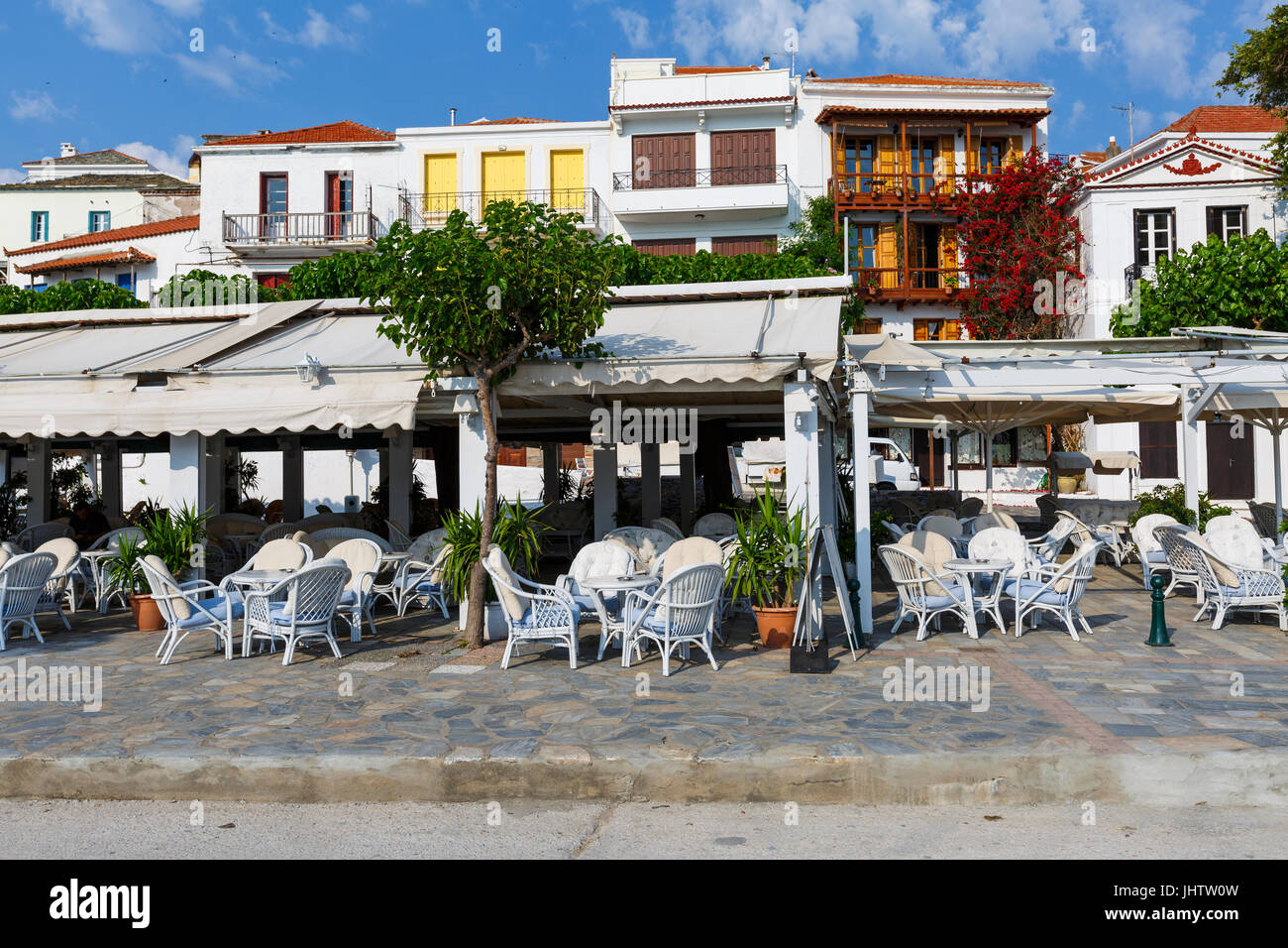 View of coffee shops in Skopelos town, Greece. - Stock Image