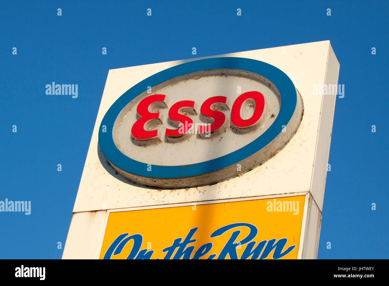 White red and blue advertising sign of  the esso with a blue sky in the background - Stock Image