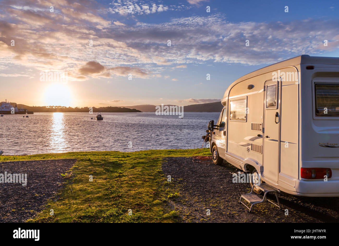 Campervan (Motorhome) at a campsite in Craignure at sunset, Isle of Mull, Argyll and Bute, Scotland, UK - Stock Image