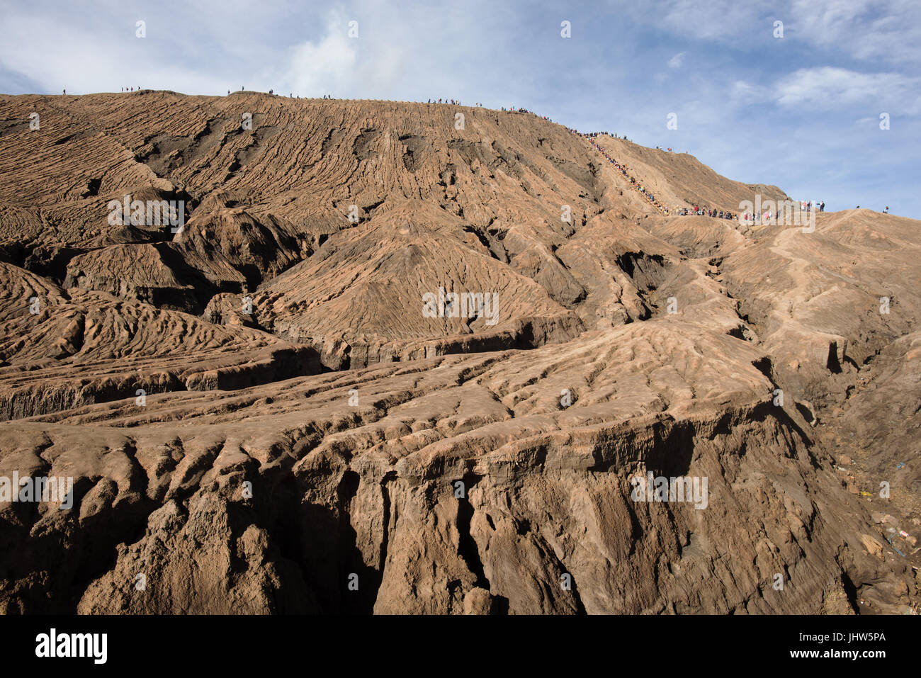 Tourists climbing to crater of Mount Bromo active volcano, East Java INdonesia. - Stock Image
