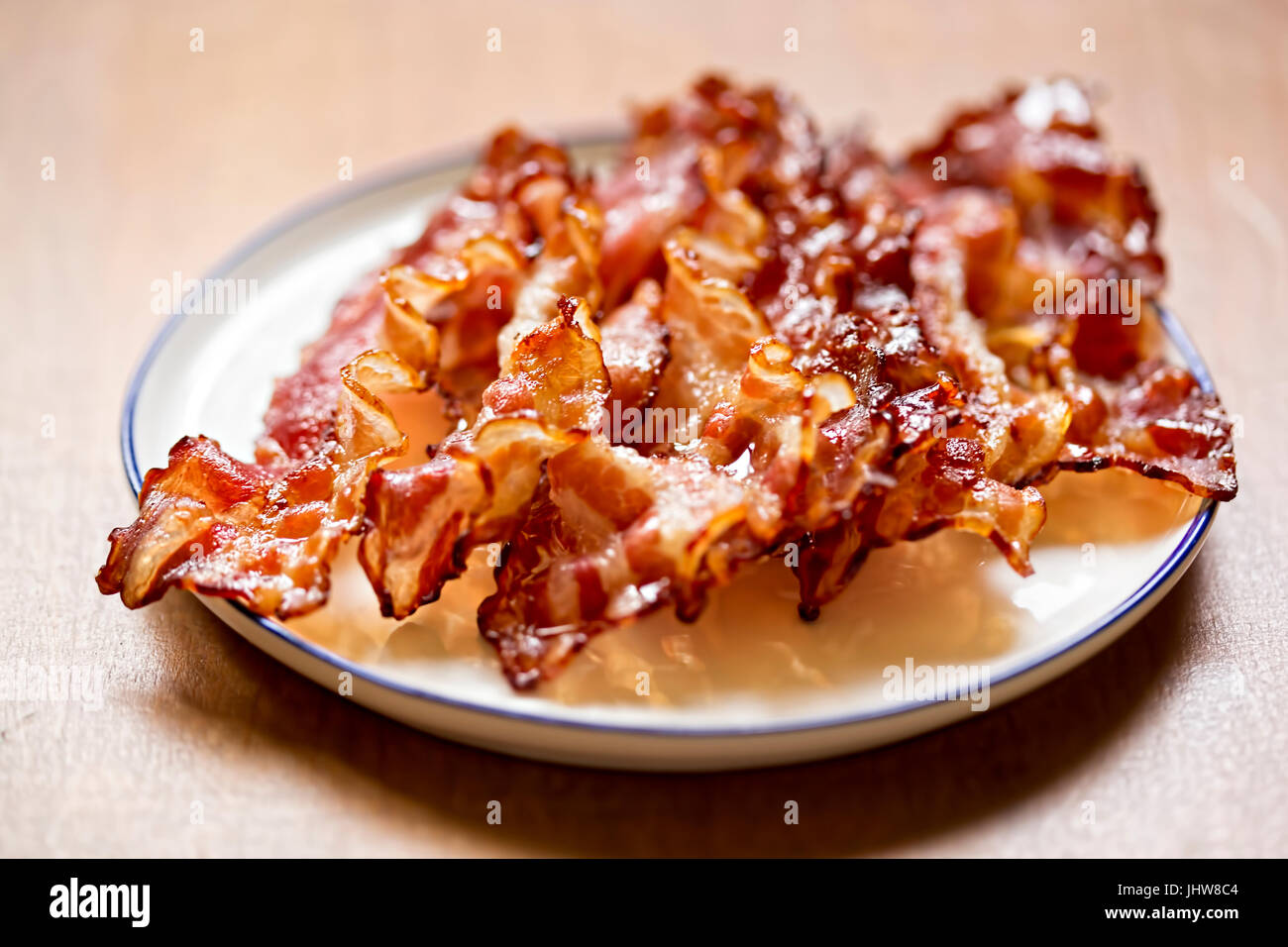 Streaky fried bacon rashers - Stock Image