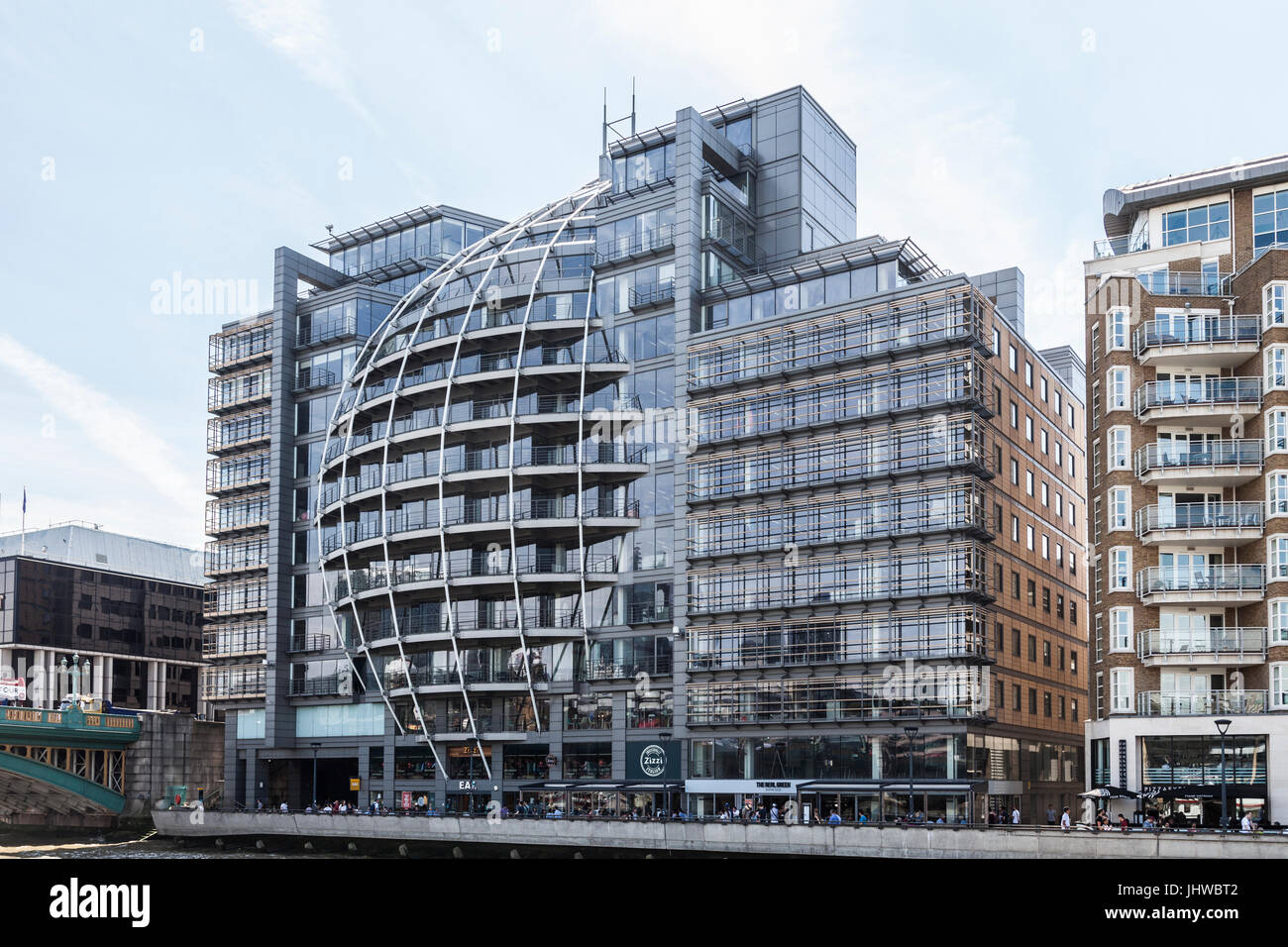 Riverside House, a distinctive office block, with Zizzi, Eat and The Real Greek restaurants on the ground floor. Stock Photo