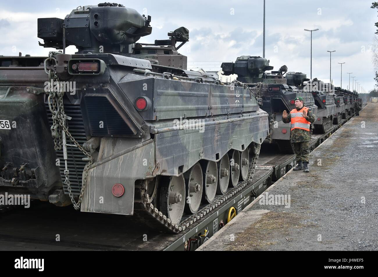 German soldiers load tracked Marder infantry fighting vehicles onto railway carts at the Grafenwoehr Tower Barracks - Stock Image