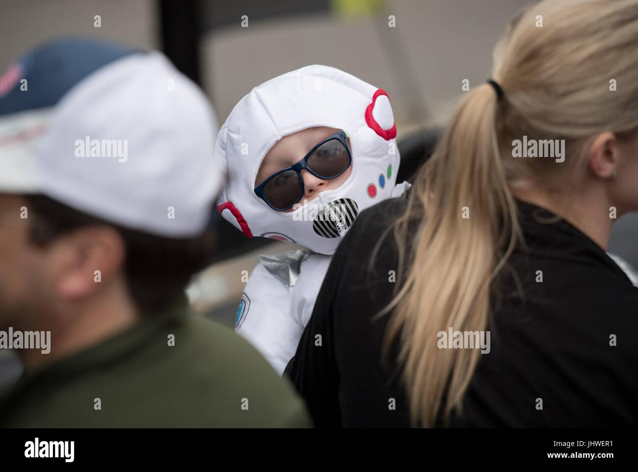 A child dressed as an astronaut participates in a costume contest during the NASA Mars New Year celebration May - Stock Image