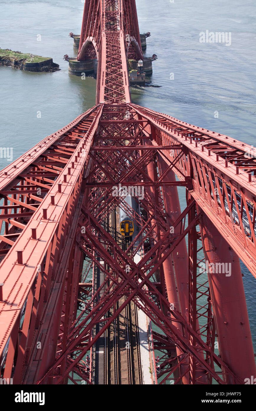 North Queensferry, The Forth Bridge (Fife) view fromthe top of  the north cantilever as a Scotrail train crosses - Stock Image