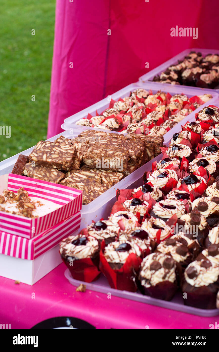 Cream and chocolate cupcakes for sale at the farmers market, cakes for sale, cake sale abundance, tasty, spoilt Stock Photo
