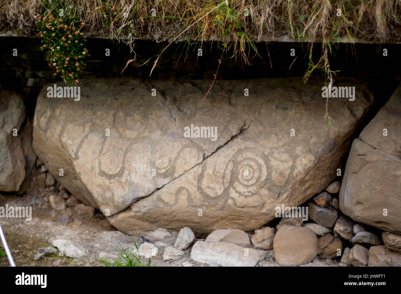 Neolithic art displayed on large stones, Kerbstones with spirals and lozenges at Knowth, Boyne Valley, Meath Ireland - Stock Image