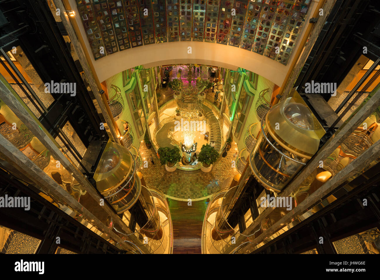 View of the elevator shafts, elevators, lobby and staircases in the cruise ship Navigator of the Seas (Royal Caribbean - Stock Image