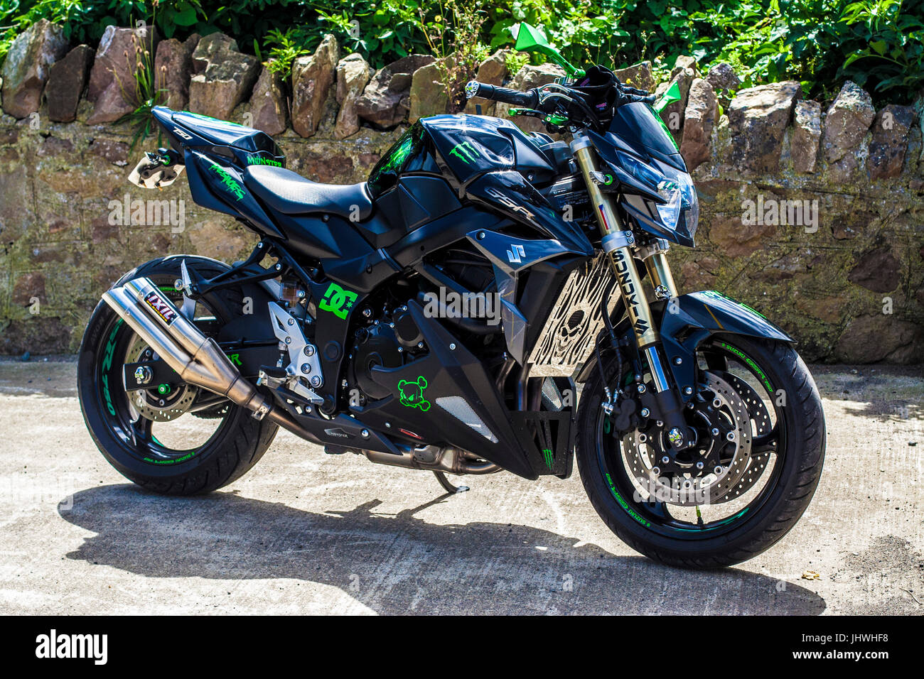black silver and green suzuki motorcycle ixil - Stock Image