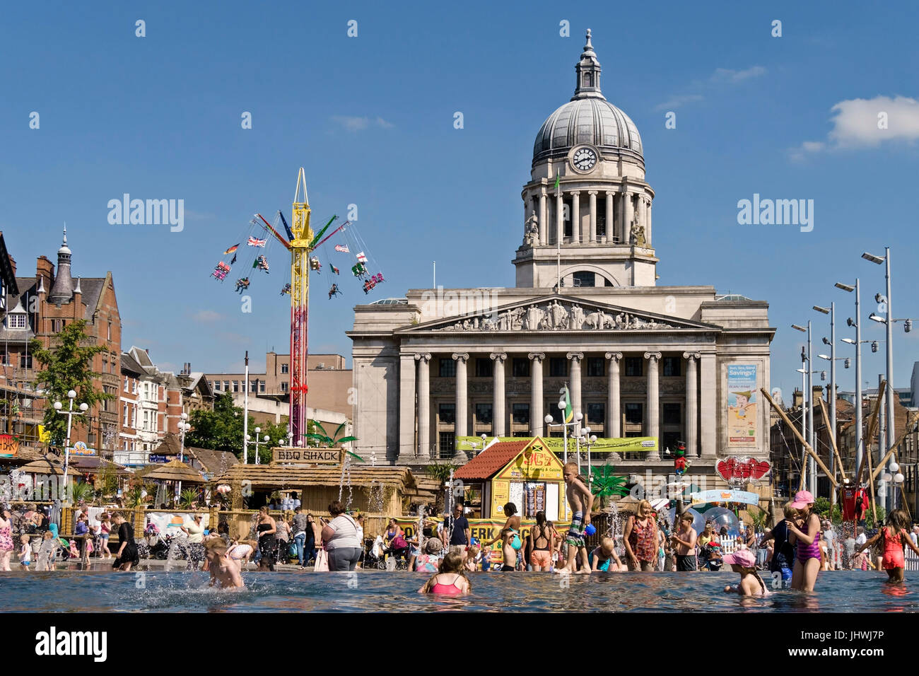 Children playing in water fountains in Old Market Square during Nottingham Beach 2016 Summer fare with Nottingham - Stock Image