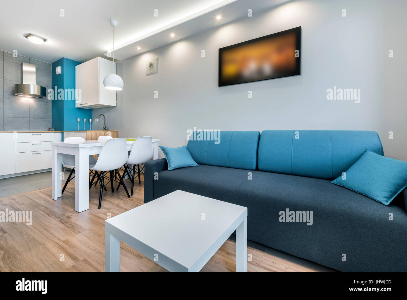 Modern Living Room With Grey Walls And Blue Sofa Stock Photo Alamy