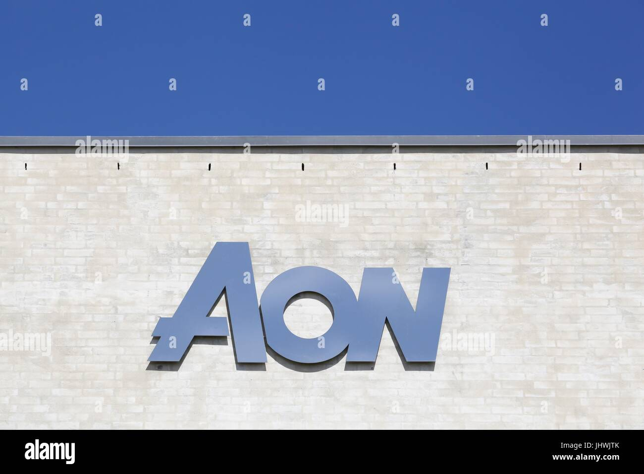 Kolding, Denmark - July 9, 2017: Aon is a British multinational corporation that provides risk management, insurance - Stock Image