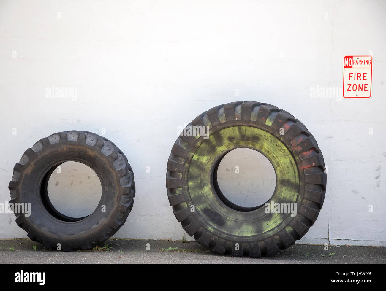 Tires in front of a Crossfit fitness center in New Jersey - Stock Image