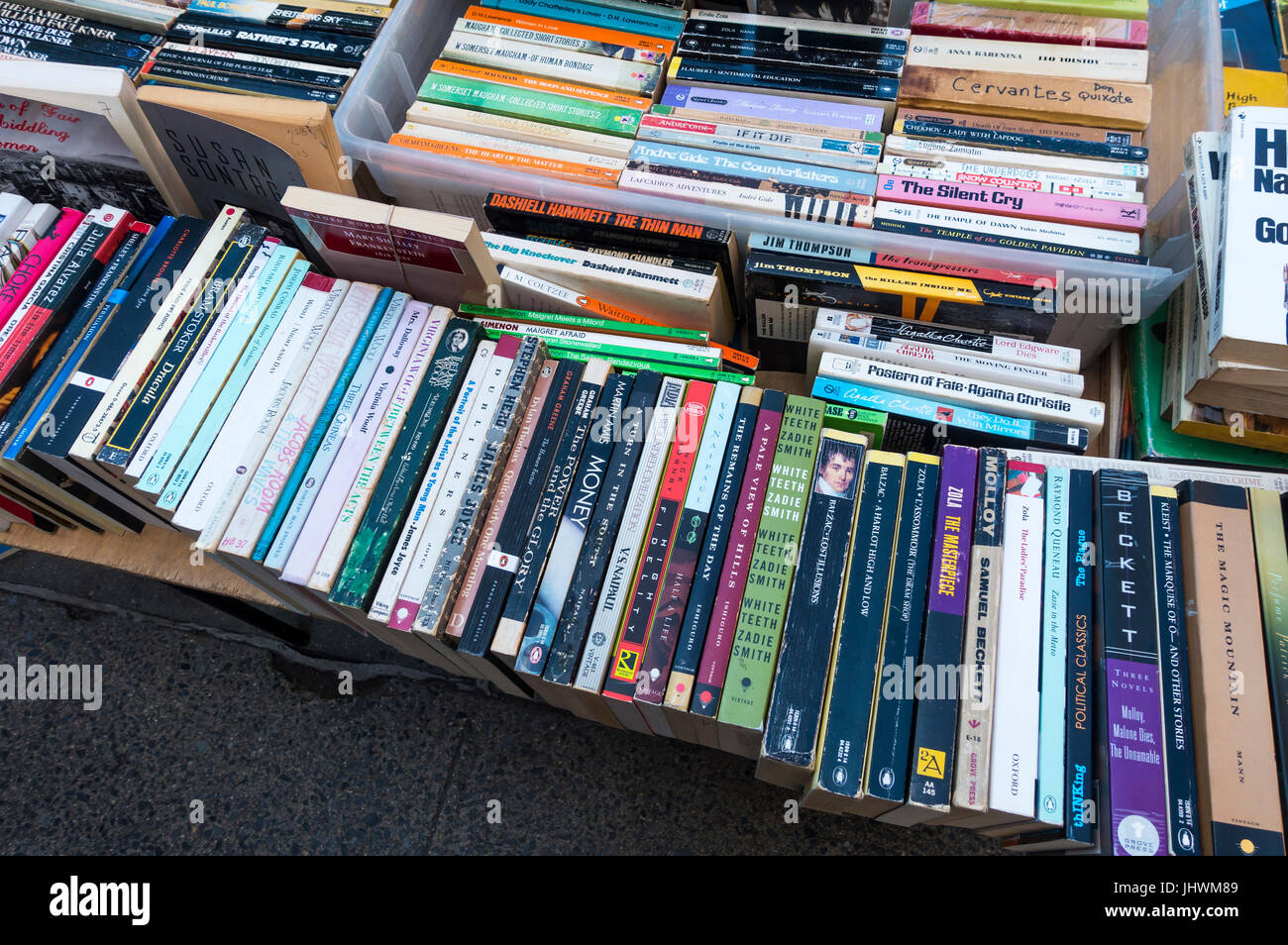Used paperback books for sale at a street stand in New York City - Stock Image