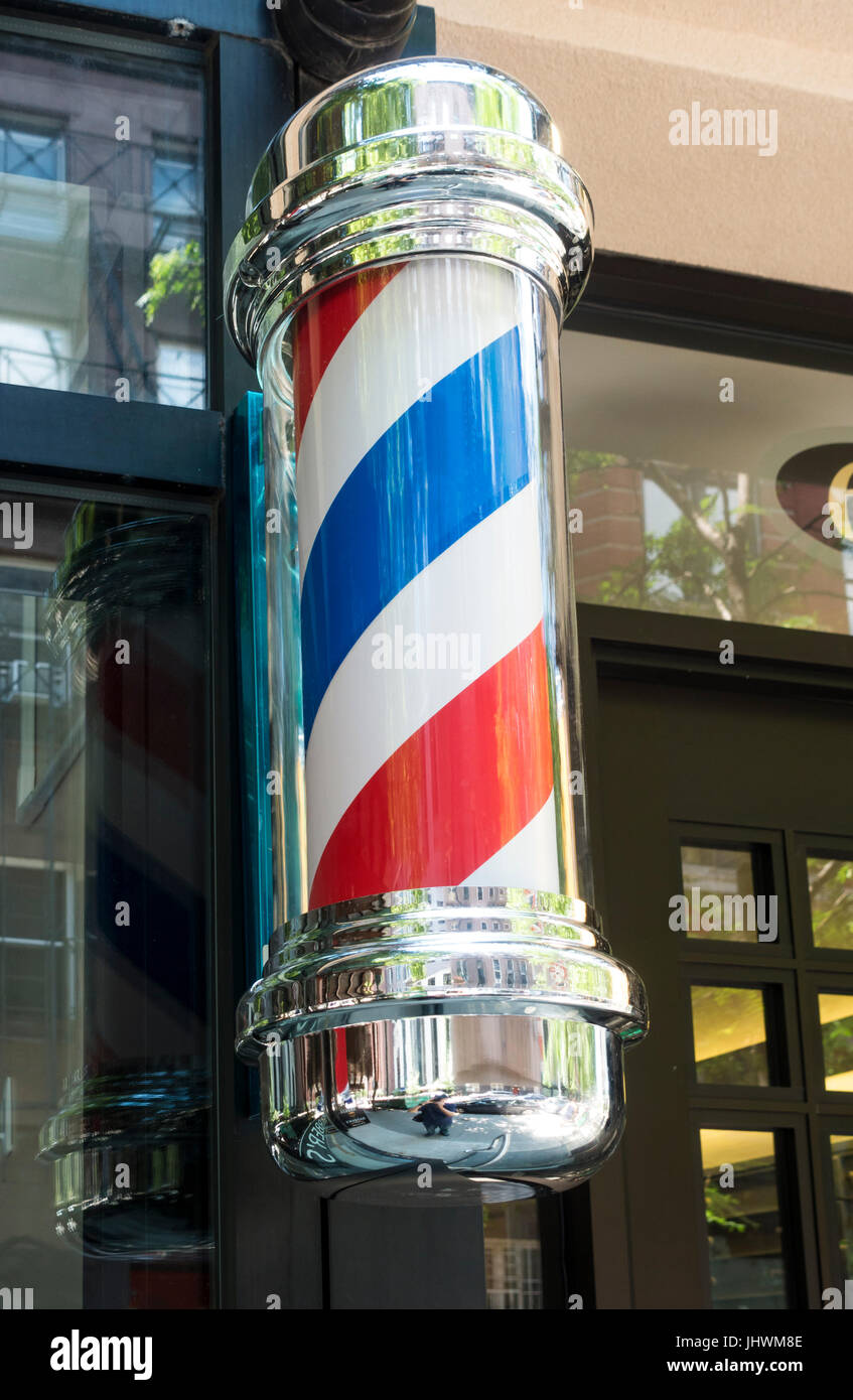 Barber's pole outside a shop in New York City - Stock Image
