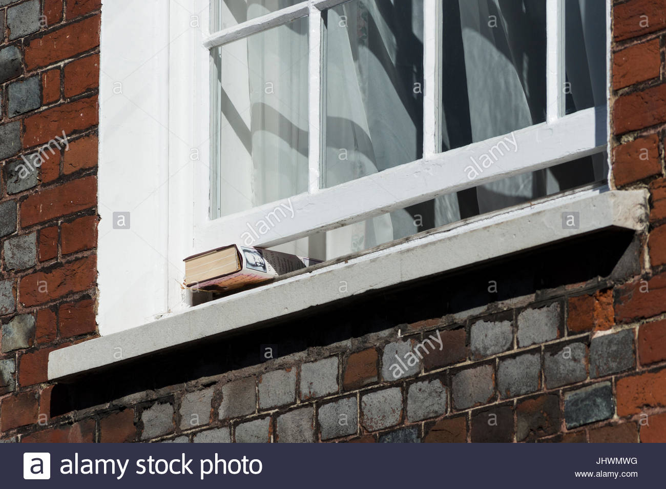 A hardback copy of the Winston and Clementine Churchill book, Speaking For Themselves, propping open an old sash Stock Photo