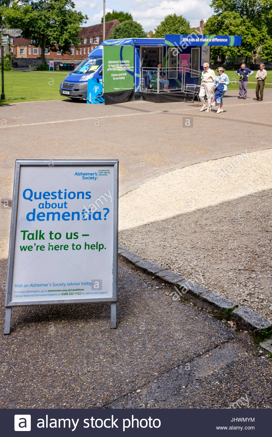 Questions About Dementia sign outside a mobile Alzheimers Society Drop-in van - Stock Image