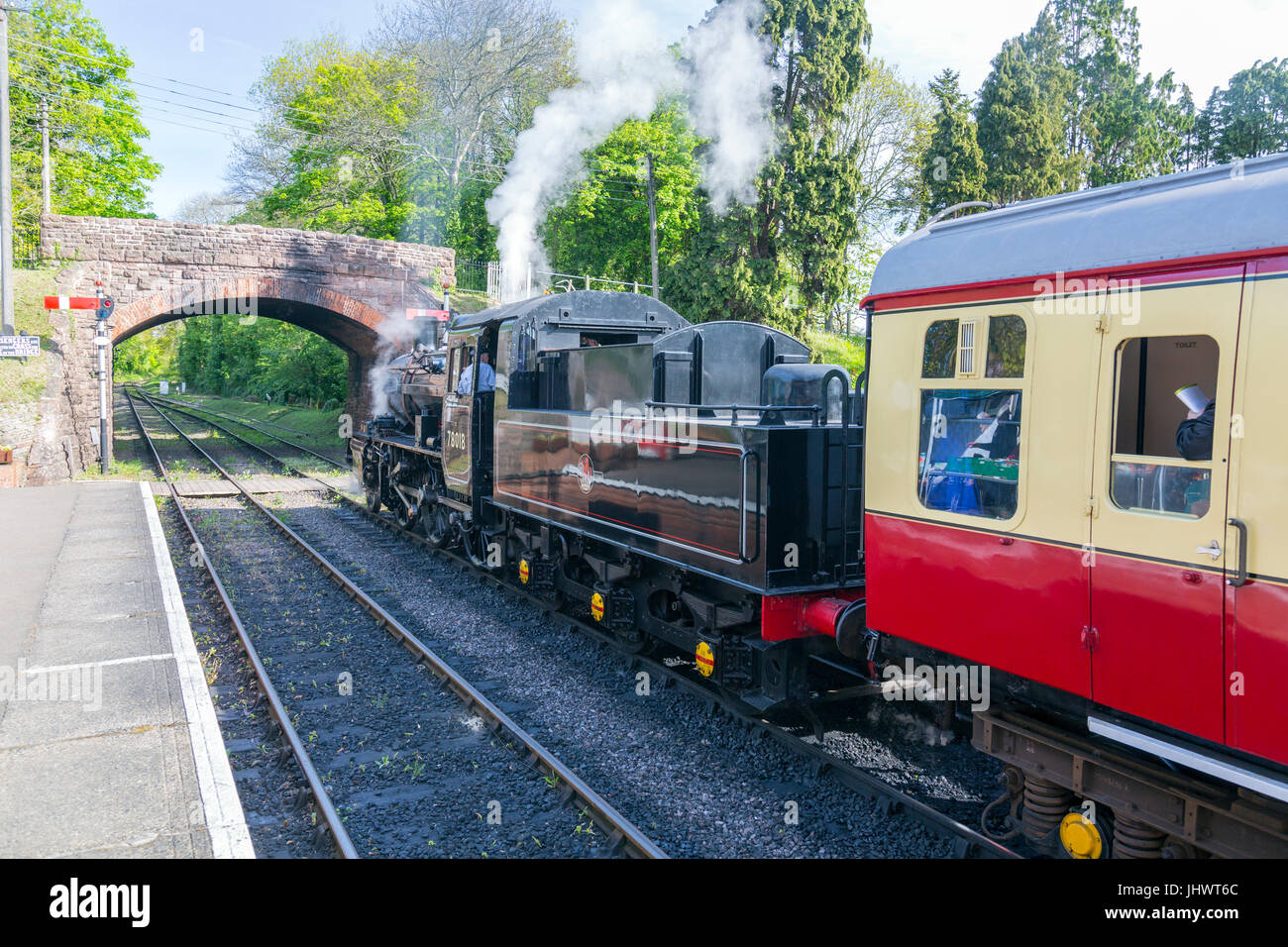 Ex-BR loco 78018 waits to depart from Bishops Lydeard station with a train to Minehead on the West Somerset Railway, Stock Photo