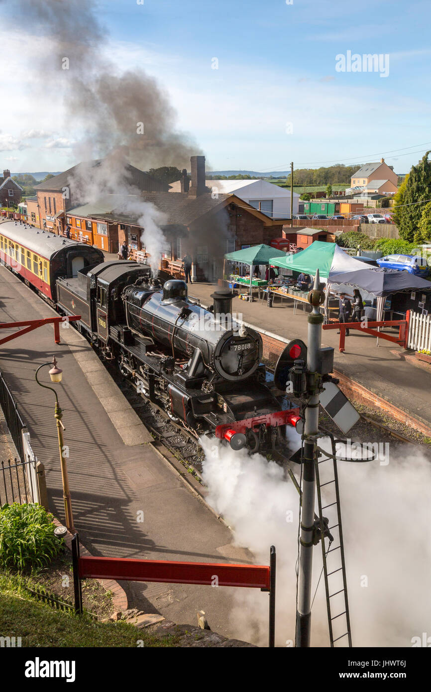 Ex-BR loco 78018 departs from Bishops Lydeard station with a train to Minehead on the West Somerset Railway, UK Stock Photo