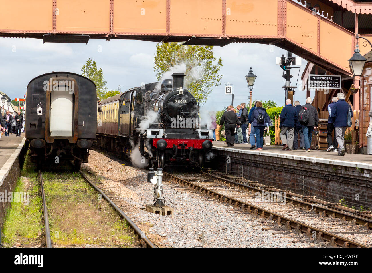 Ex-BR loco 78018 arrives at Williton station with a train to Bishops Lydeard on the West Somerset Railway, UK Stock Photo