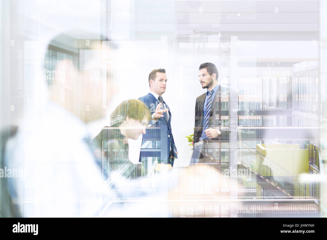 Business people in modern office. - Stock Image