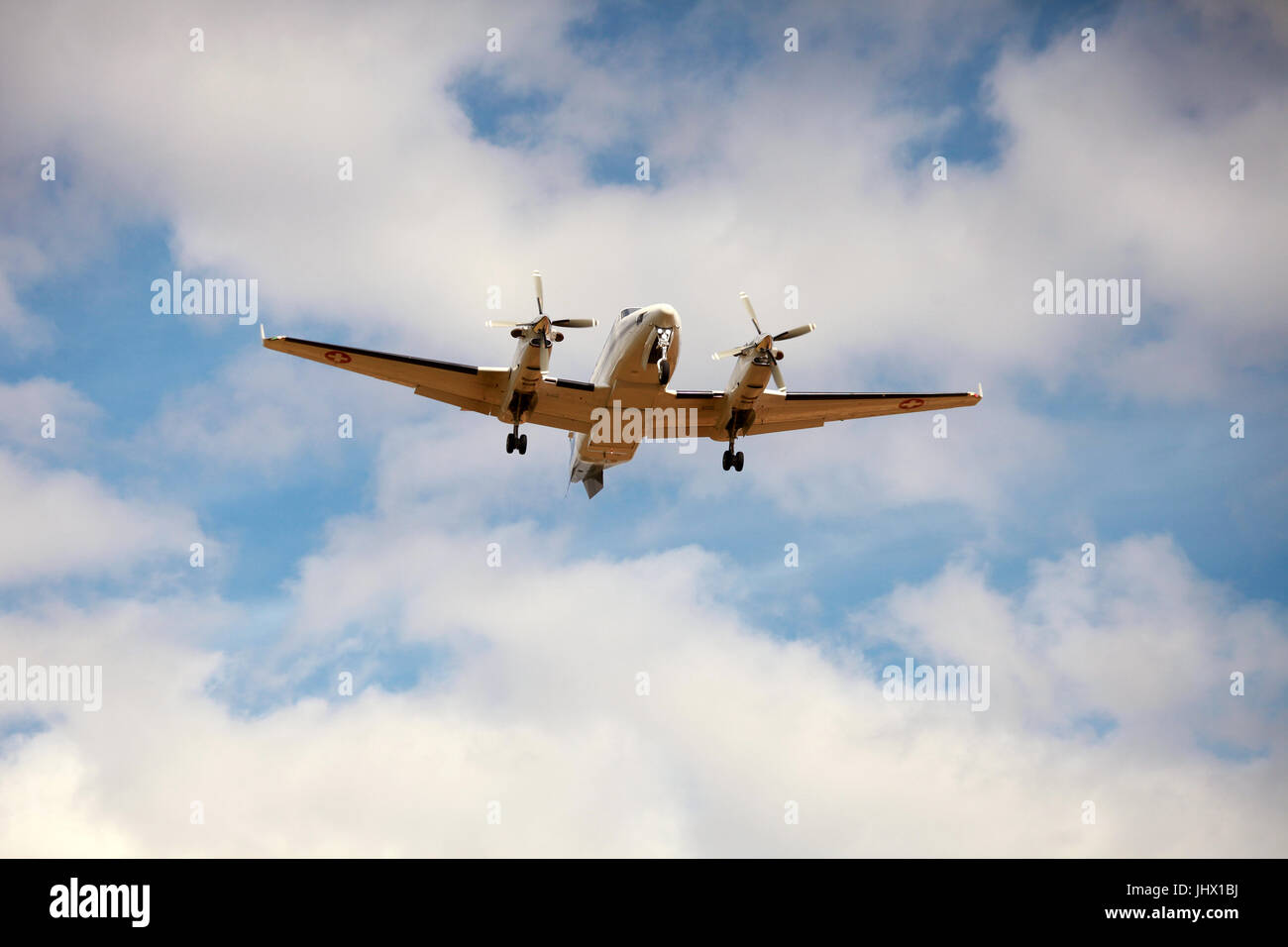 passenger aircraft landing at airport - Stock Image