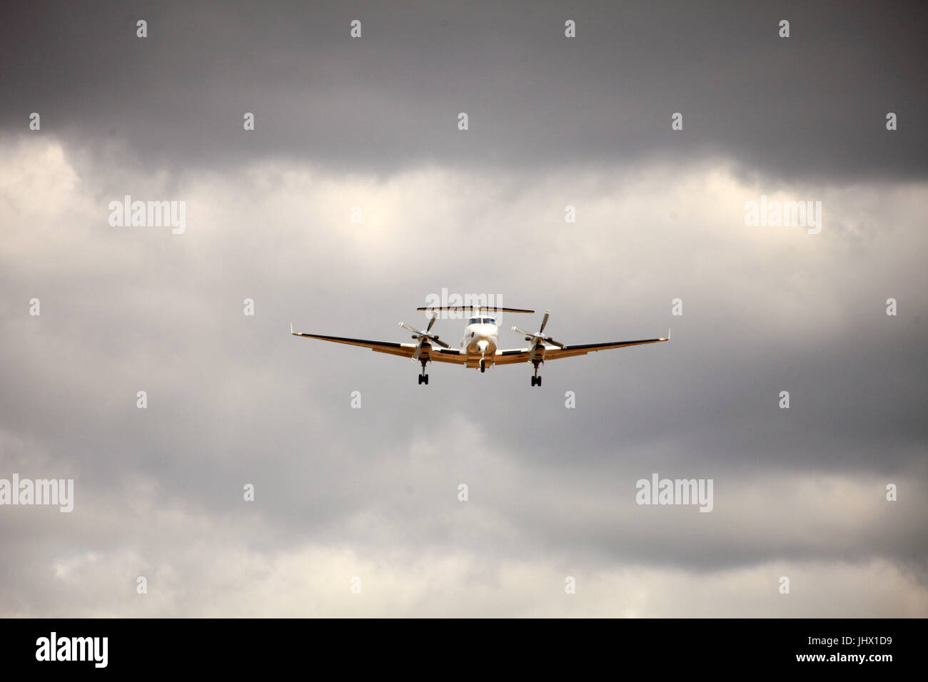 passenger aircraft landing at airport Stock Photo