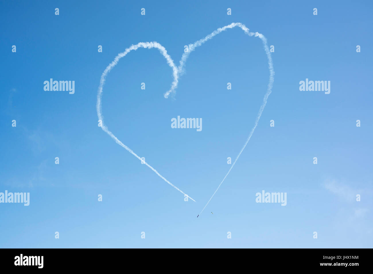 Planes making a heart in sky writing at the Milwaukee Air Show - Stock Image