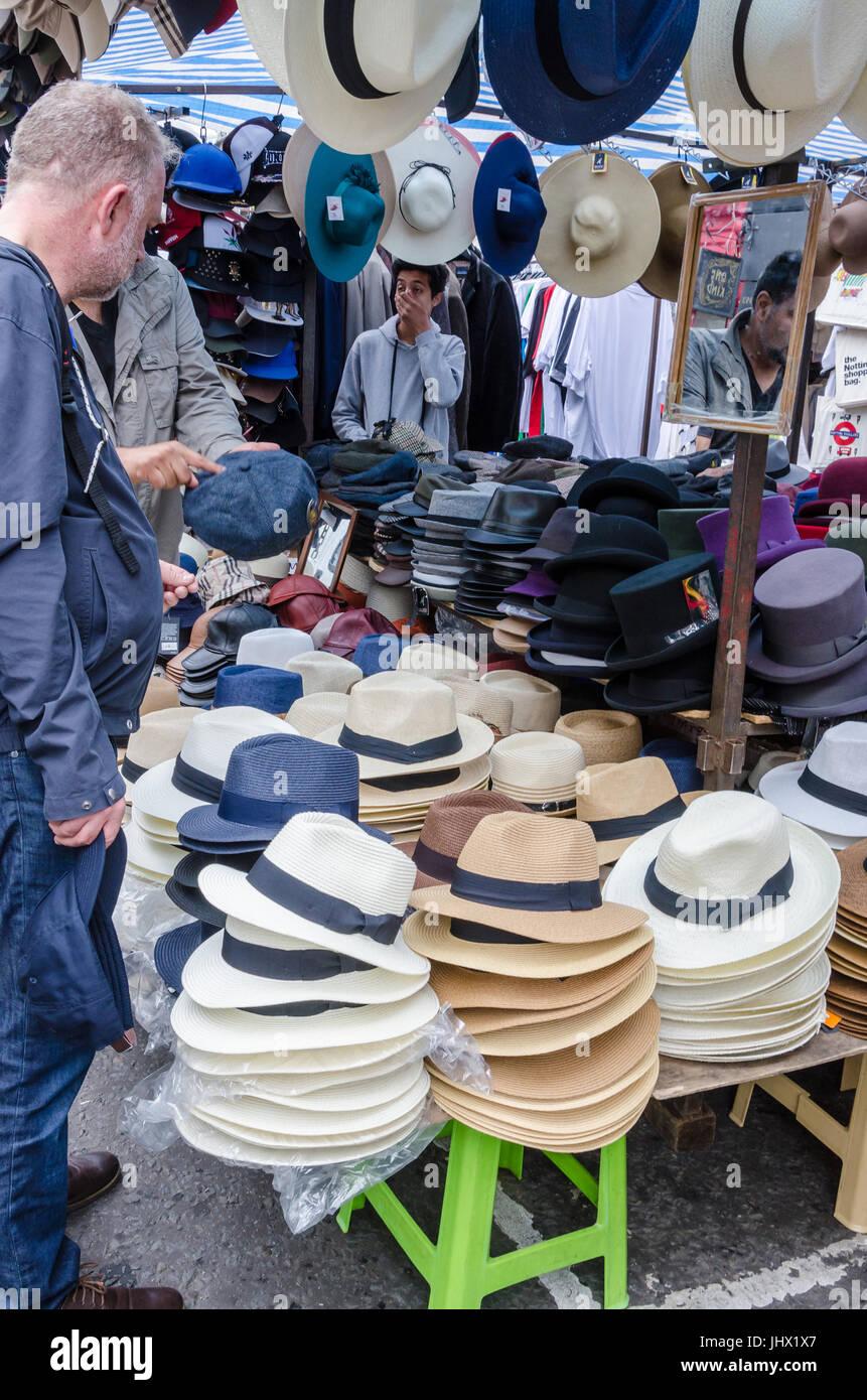A stall selling hats in Portobello market. - Stock Image