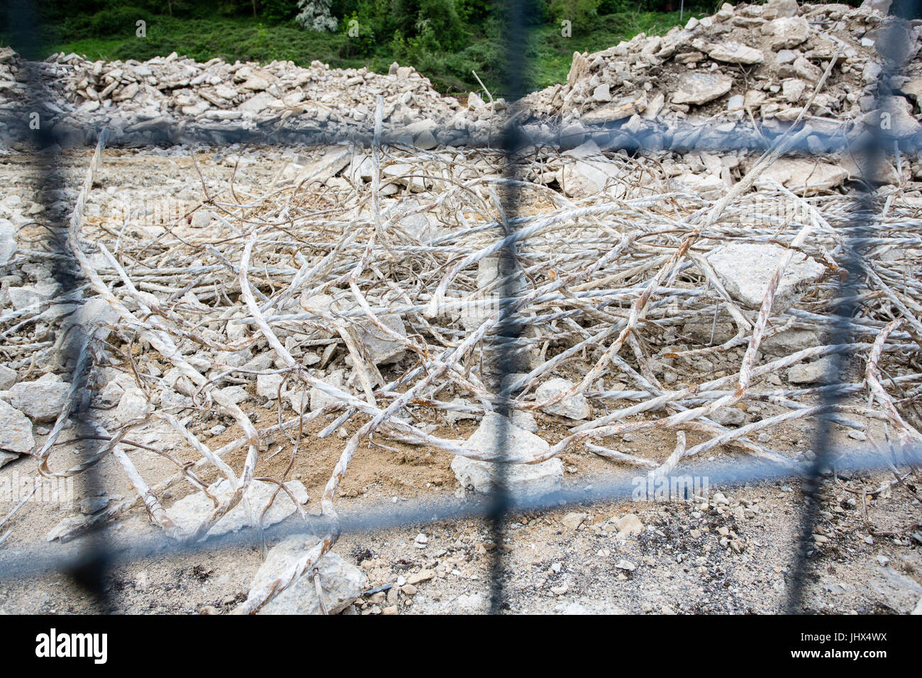Piles of twisted wire and rubble on a construction site where Stock ...