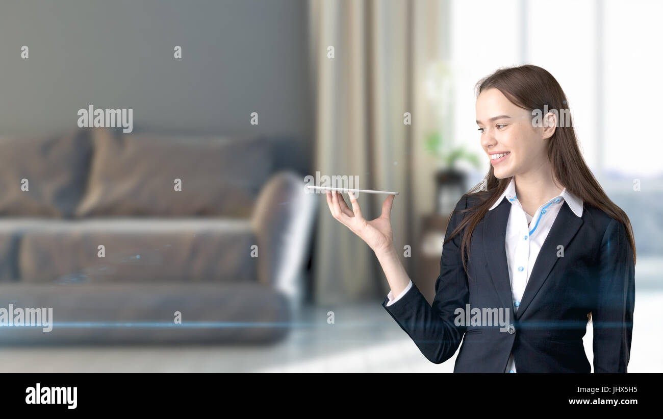 Young beautiful business woman and creative designer standingover blured 3D interior on background. Concepr of succesful - Stock Image