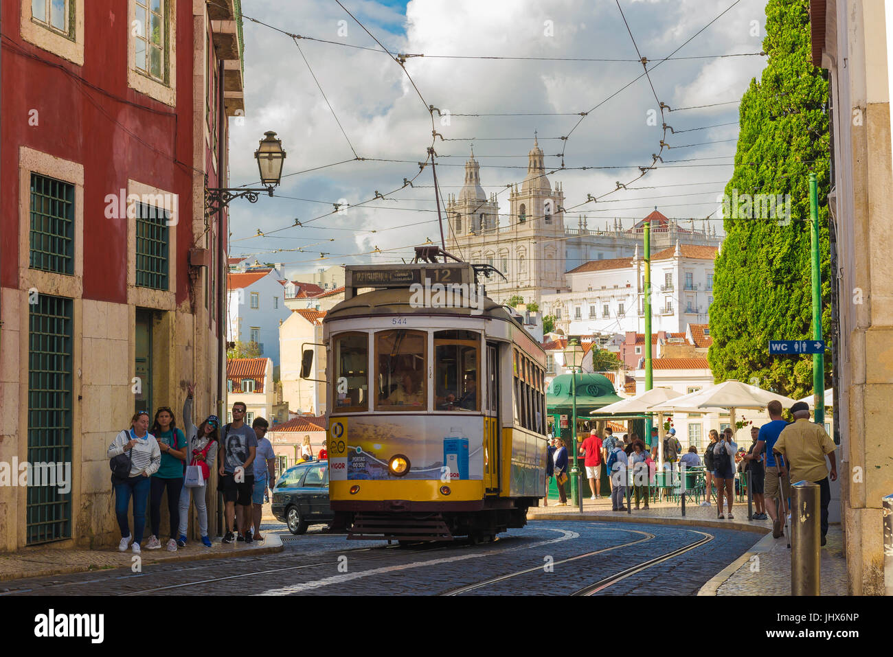Lisbon tram, a no.12 tram leaves the Porta do Sol high up in the Alfama district and heads along the Largo Santa Stock Photo