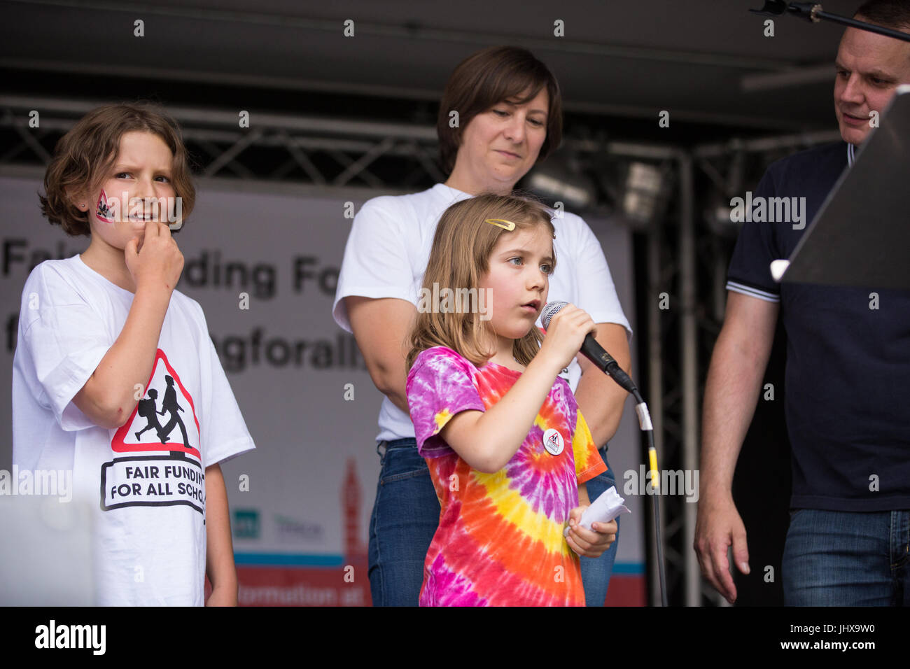 London, UK. 16th July, 2017. Didi Allan, 8, Highgate Primary School pupil, addresses campaigners against cuts to Stock Photo