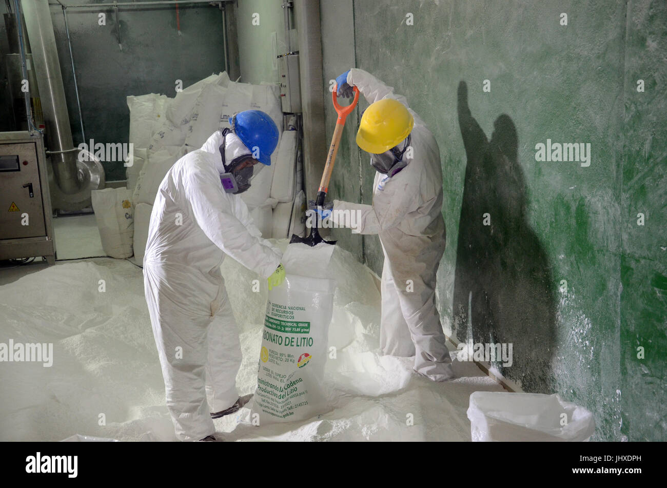 WOrkers fill lithium carbonate in 20-kilogram sacks in the Uyuni