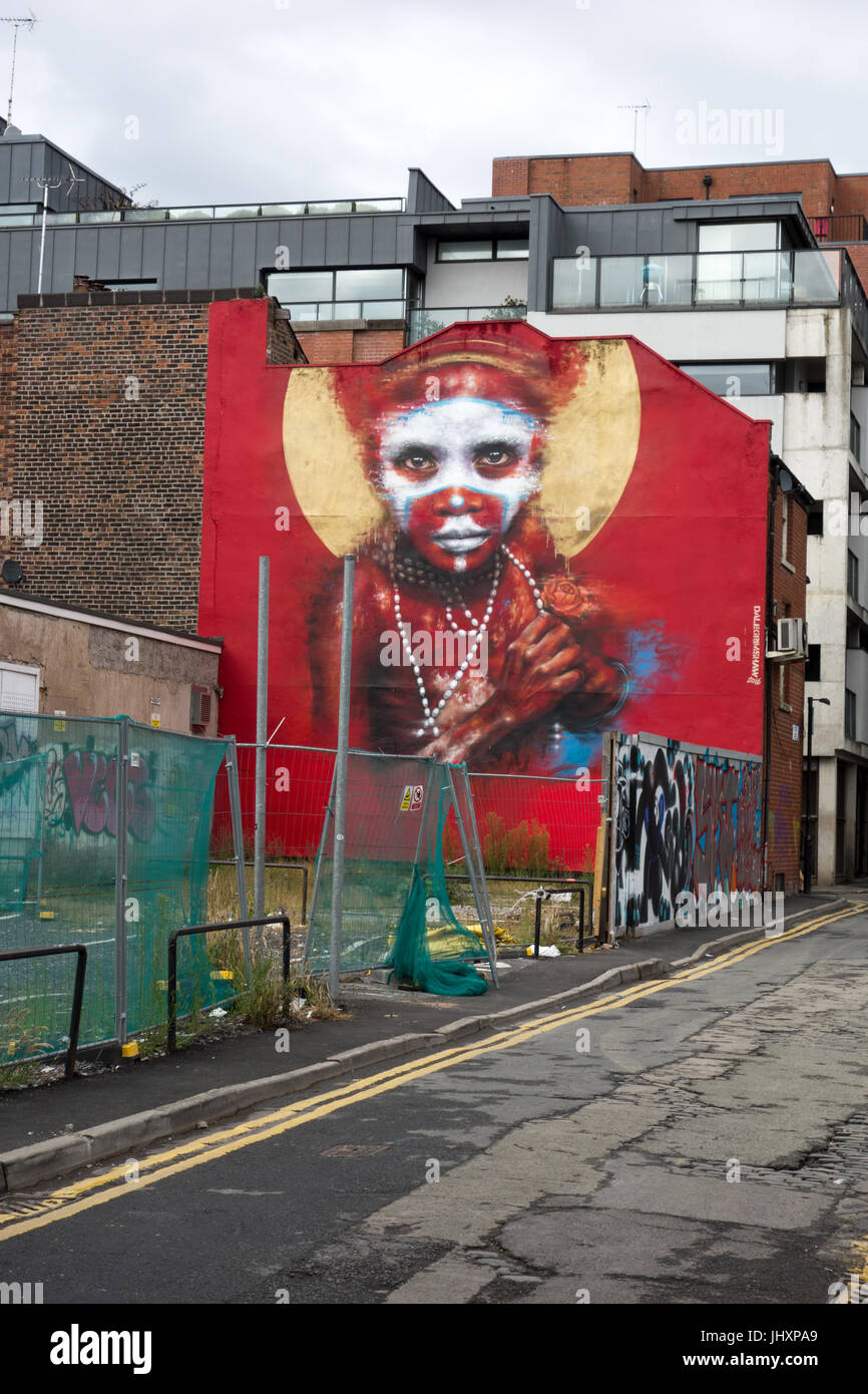 Giant mural portrait of a Papua New Guinea Child by UK artist Dale Grimshaw on Spear Street, Northern Quarter, Manchester, - Stock Image